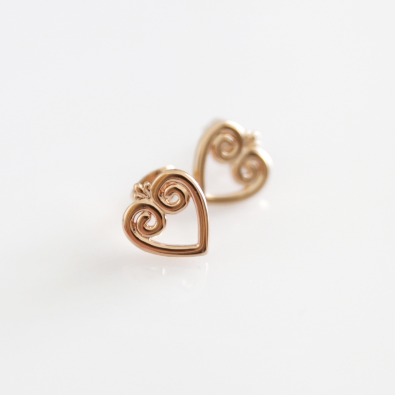 FOLKIE stud earrings with pink-gold hearts